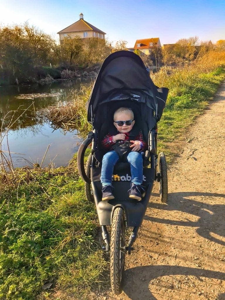 Child outdoors in Nipper Sport pushchair
